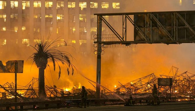 An apartment building under construction burns in Los Angeles.