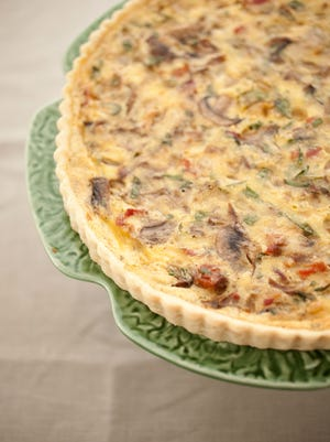 Swiss Cheese Quiche with Bacon, Mushrooms, and Artichoke.