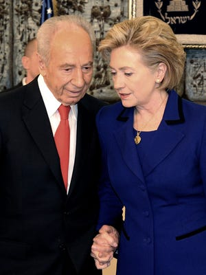 A handout image provided by the Israeli Government Press Office and made availabe on Sept. 28 shows then Israel President Shimon Peres in a conference with then U.S. Secretary of State Hilary Clinton in Israel, 03/03/2009.