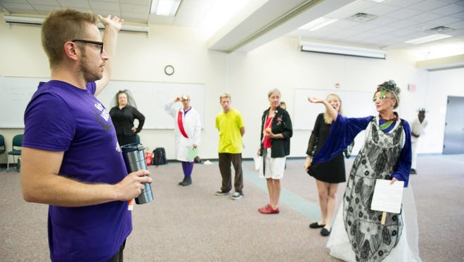 David Henderson, of Rochester, directs the cast to practice gestures during dress rehearsal for Grimms' Mad Tales, stories of the Brothers Grimm.