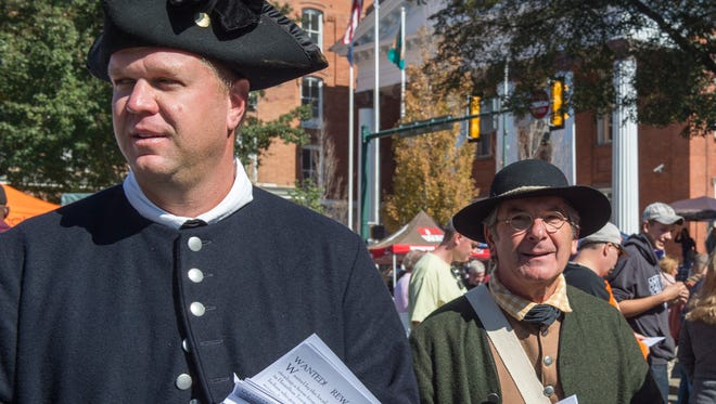 "Reenactors walk around downtown Chambersburg during AppleFest announcing a performance of ""Justice on the Falling Spring,"" at the Old Jail courtyard on Saturday, Oct 15, 2016."