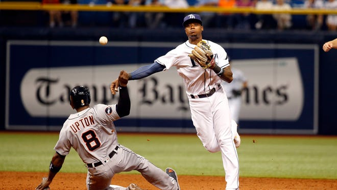 Tigers leftfielder Justin Upton (8) breaks up a double play attempt by Rays shortstop Tim Beckham (1) after being forced at second base during the seventh inning  of the Tigers' 5-1 loss Tuesday in St. Petersburg, Fla.