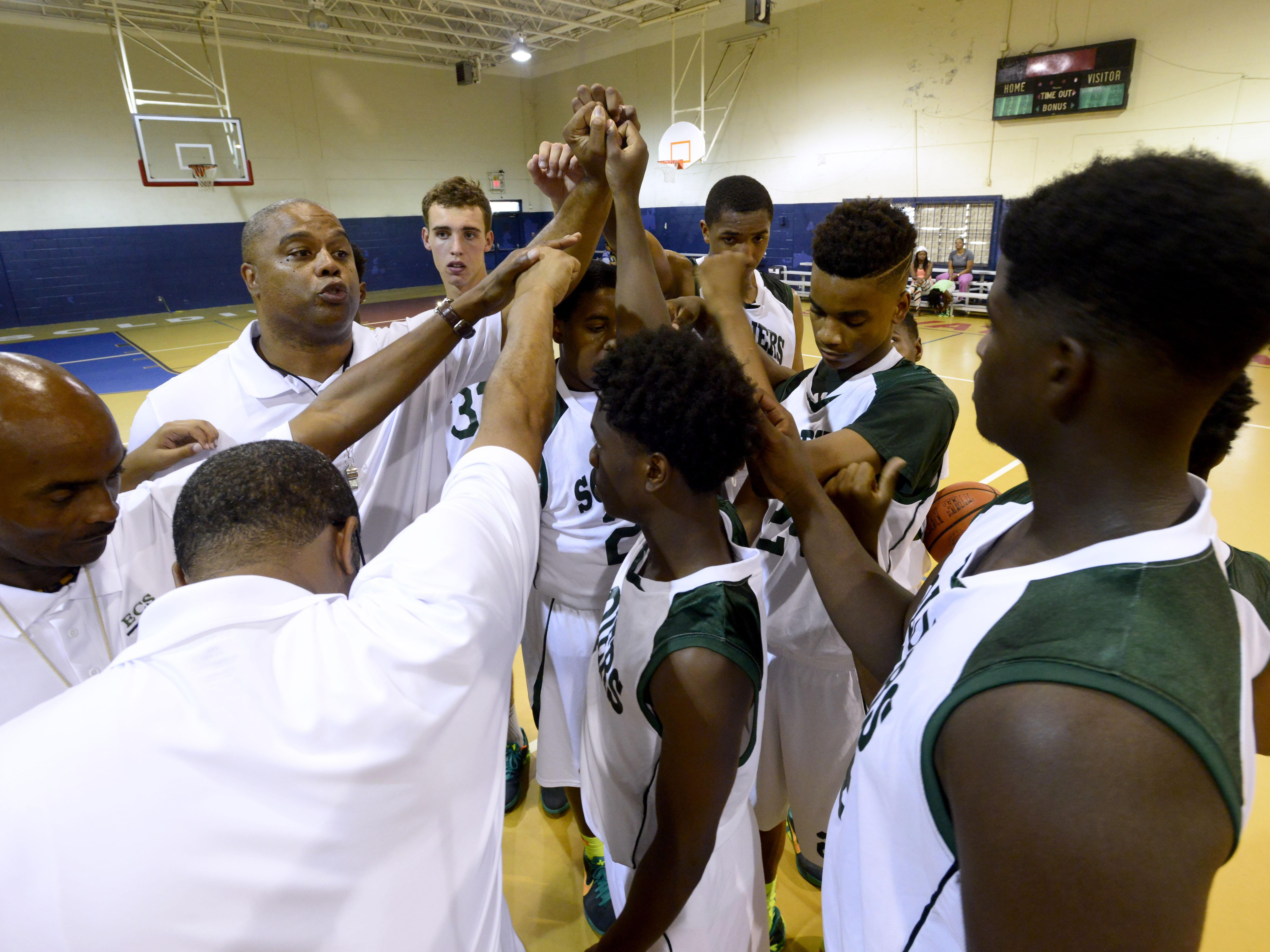 Head coach Dwayne Kelley gathers his players during practice on Monday at the Salvation Army gymnasium. The team is representing Pensacola in the AAU Nationals in Memphis this weekend.
