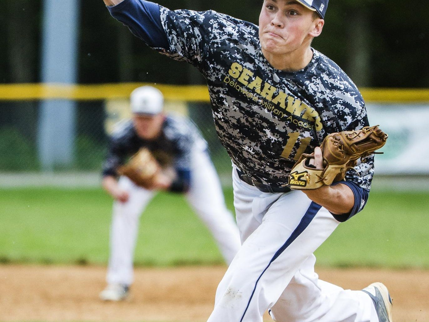 Delaware Military Academy's Matthew Danz delivers a pitch in Conrad's 1-0 win over Delaware Military Academy in Newark on Tuesday afternoon.