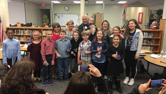Students from Netcong Elementary School with with the D'Amico family (back, center) of Mount Arlington on Dec. 13, after the students donated to the family's Kindness for Christopher campaign in memory of their son, Christopher D'amico, who died in a boating accident on Lake Hopatcong in 2015..
