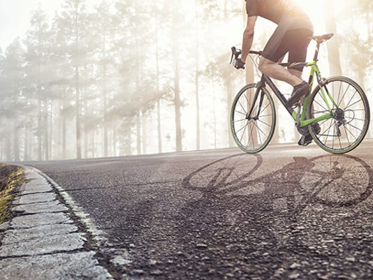 professional-cyclist-on-a-forest-road-sq.jpg