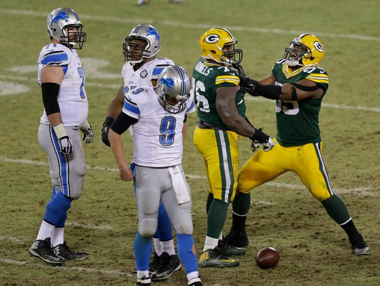 Green Bay Packers defensive end Datone Jones, right,
