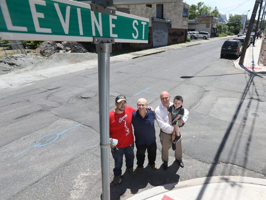 Andrew, Ted Jeffrey and Mike Levine in Paterson on Monday.