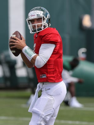 Michigan State quarterback Tyler O'Connor goes through drills during practice at the Duffy Daugherty football facility in East Lansing, MI, Monday, August 22, 2016.