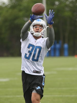 Lions rookie defensive back  Teez Tabor works with the passing machine during OTAs on Wednesday, May 24, 2017 at the Allen Park practice facility.