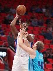 Pistons' Andre Drummond scores a hook shot against the Hornets' Cody Zeller in the second quarter at Little Caesars Arena in Detroit, Wednesday, Oct. 4, 2017.