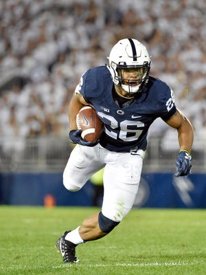 Penn State's Saquon Barkley carries a reception against Michigan in the second half of an NCAA Division I college football game Saturday, Oct. 21, 2017, at Beaver Stadium. The No. 2 Penn State Nittany Lions defeated Michigan 42-13, improving their season record to 7-0.