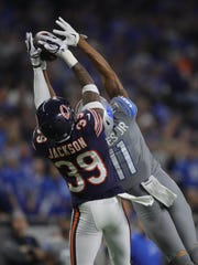 Detroit Lions' Marvin Jones Jr. makes a catch against the Chicago Bears' Eddie Jackson in the second quarter Saturday, Dec. 16, 2017 at Ford Field in Detroit.