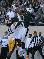 Sept. 30: Michigan State's Felton Davis III catches