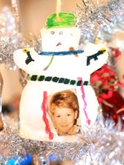 From the Will Higgins collection: Bloody, gun-toting snowman holiday ornament.