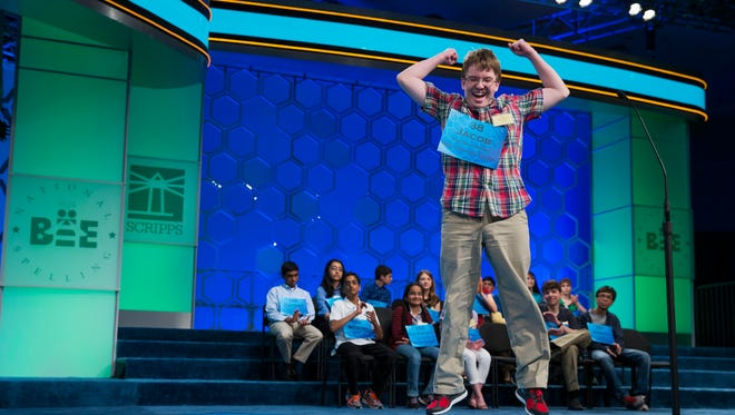 "Eighth-grade home-schooled student Jacob Williamson, 15, of Cape Coral, Fla., reacts after correctly spelling the word ""harlequinade"" during the semifinals of the Scripps National Spelling Bee in 2014."