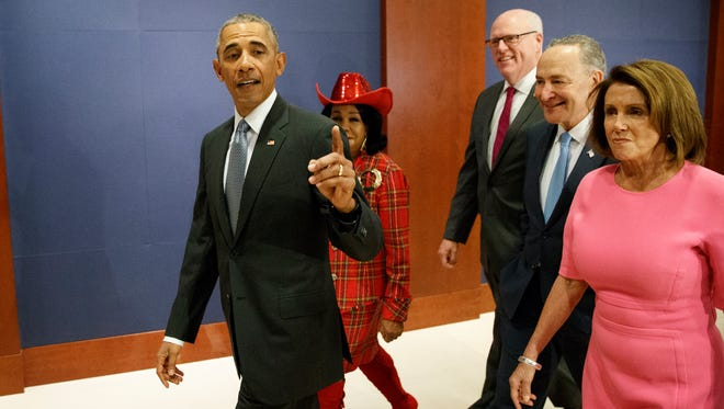 President Obama. joined by Rep. Frederica Wilson, D-Fla., Rep. Joseph Crowley, D-N.Y., Senate Minority Leader Charles Schumer, D-N.Y., and House Minority Leader Nancy Pelosi, D-Calif.. arrives on Capitol Hill on Jan. 4, 2017, to meet with members of Congress to discuss his signature health care law.