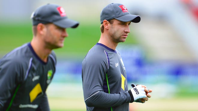In a file picture taken on December 13, 2012 Australia's player Phil Hughes (R) looks on with captain Michael Clarke (L) during a training session ahead of the first cricket Test match between Australia and Sri Lanka in Hobart. Australian batsman Phillip Hughes died on November 27, 2014 from the injuries sustained when he was hit by a bouncer in a domestic game this week, Cricket Australia said.