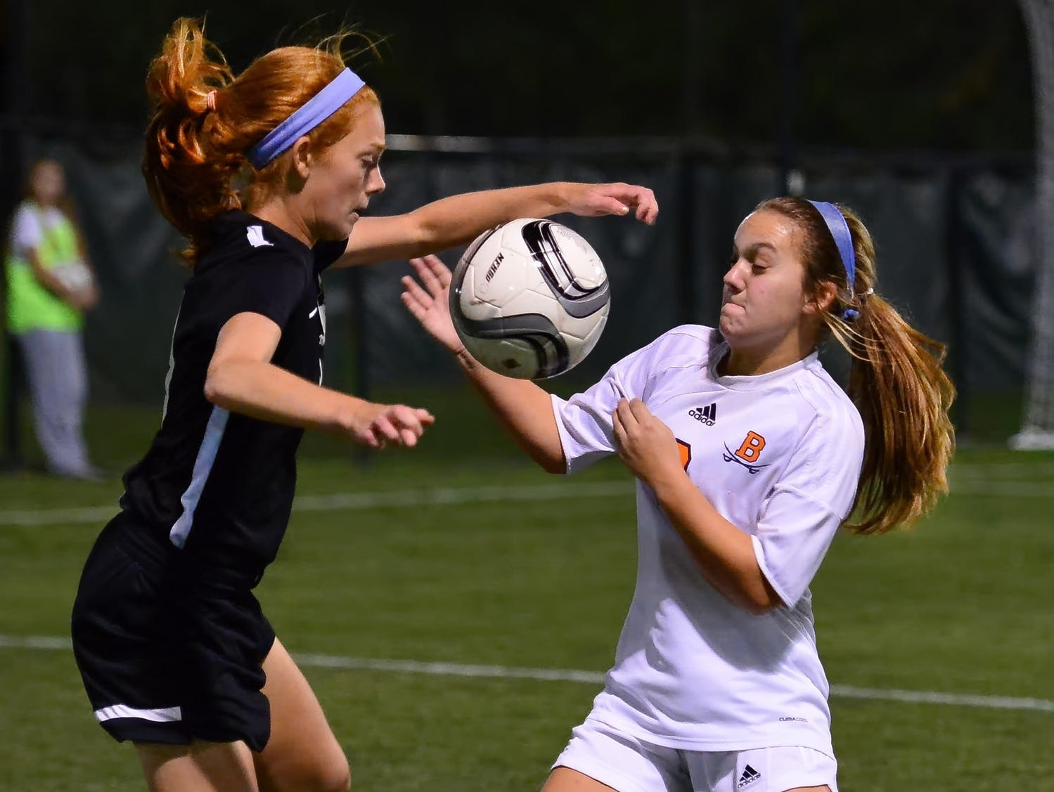 Station Camp High junior Megan Brinkley battles with Beech sophomore Natalie Lankster for possession. Brinkley scored a goal and provided an assist during the Lady Bison's 3-0 victory in Tuesday evening's District 9-AAA Tournament semifinal match.