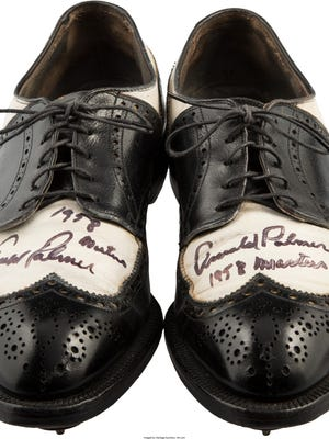 A pair of shoes worn by Arnold Palmer in the 1958 Masters were sold by Heritage Auctions.