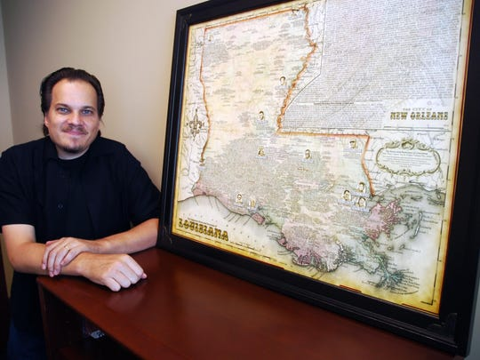 Gene Tomko with his Louisiana Music Map