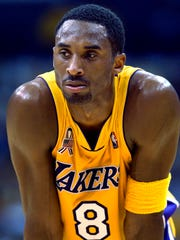 In this April 21, 2002, file photo, Los Angeles Lakers' Kobe Bryant waits between plays during the opener of a best-of-five first-round Western Conference playoff series against the Portland Trail Blazers in Los Angeles. Bryant, the 18-time NBA All-Star who won five championships and became one of the greatest basketball players of his generation during a 20-year career with the Los Angeles Lakers, died in a helicopter crash Sunday, Jan. 26, 2020. He was 41. (AP Photo/Kevork Djansezian, file)