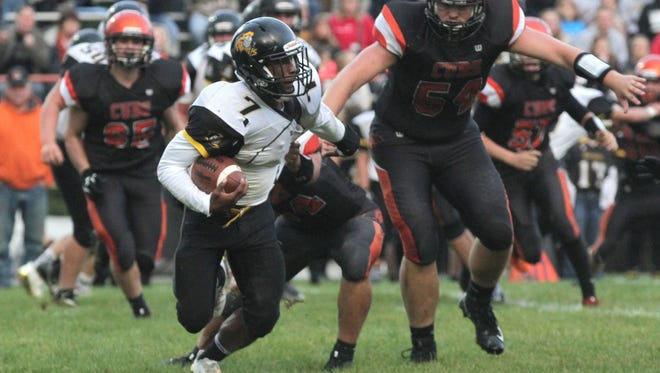 Northmor Golden Knights quarterback Meechie Johnson runs against Lucas earlier this season. Johnson has run for more than 200 yards in each of the first four games of the season.