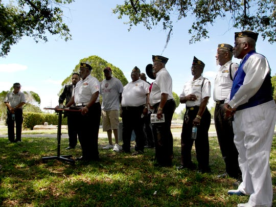 American Legion Post #192 members gather to speak at the Remembrance Celebration in honor of 6 local soldiers who died in the Vietnam War Sunday May 18 at Oak Ridge Cemetery in Fort Myers.