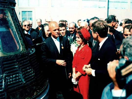 Following ceremonies at Cape Canaveral Air Force Station's Hangar S, astronaut John H. Glenn Jr. (left) describes his Friendship 7 Mercury spacecraft to his wife Annie (center) and President John F. Kennedy.