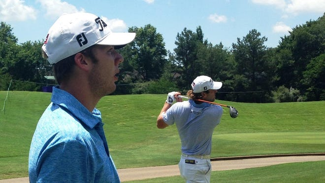 Shreveport's Sam Burns, set to attend LSU in the fall, watches the tee shot of former Tigers star Andrew Loupe during a practice round for the FedEx St. Jude Classic in Memphis on Tuesday.