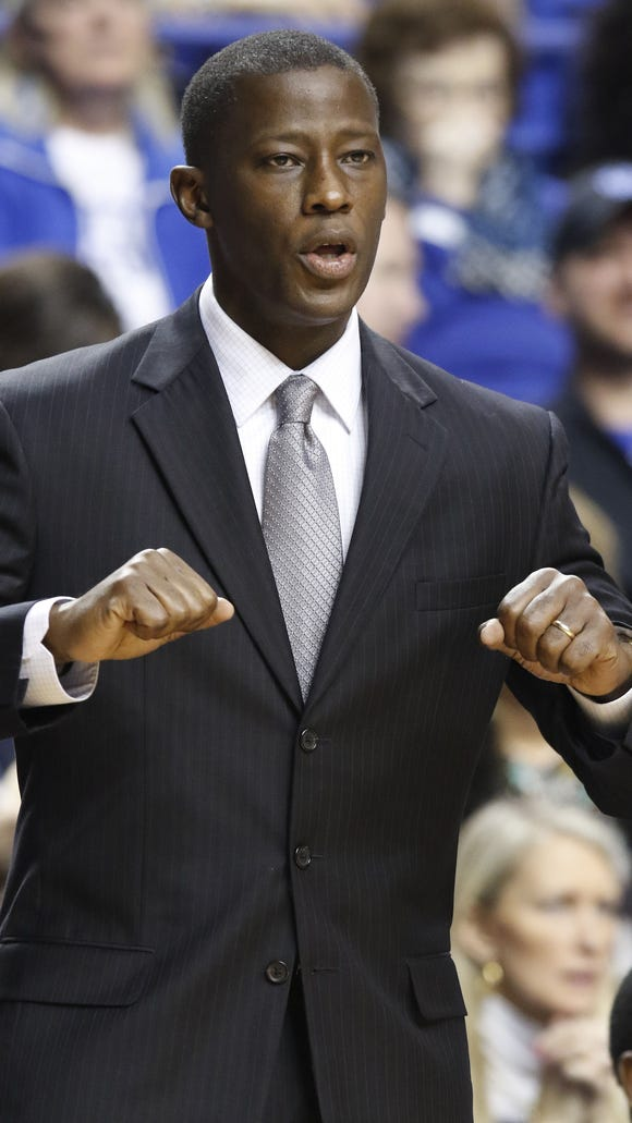 Alabama head coach Anthony Grant gestures to his team during the first half of an NCAA college basketball game against Kentucky, Saturday, Jan. 31, 2015, in Lexington, Ky. Kentucky won 70-55. (AP Photo/James Crisp)