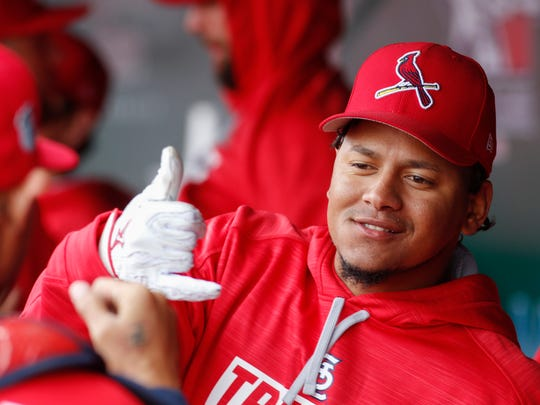 Carlos Martinez interacts with teammates inside the