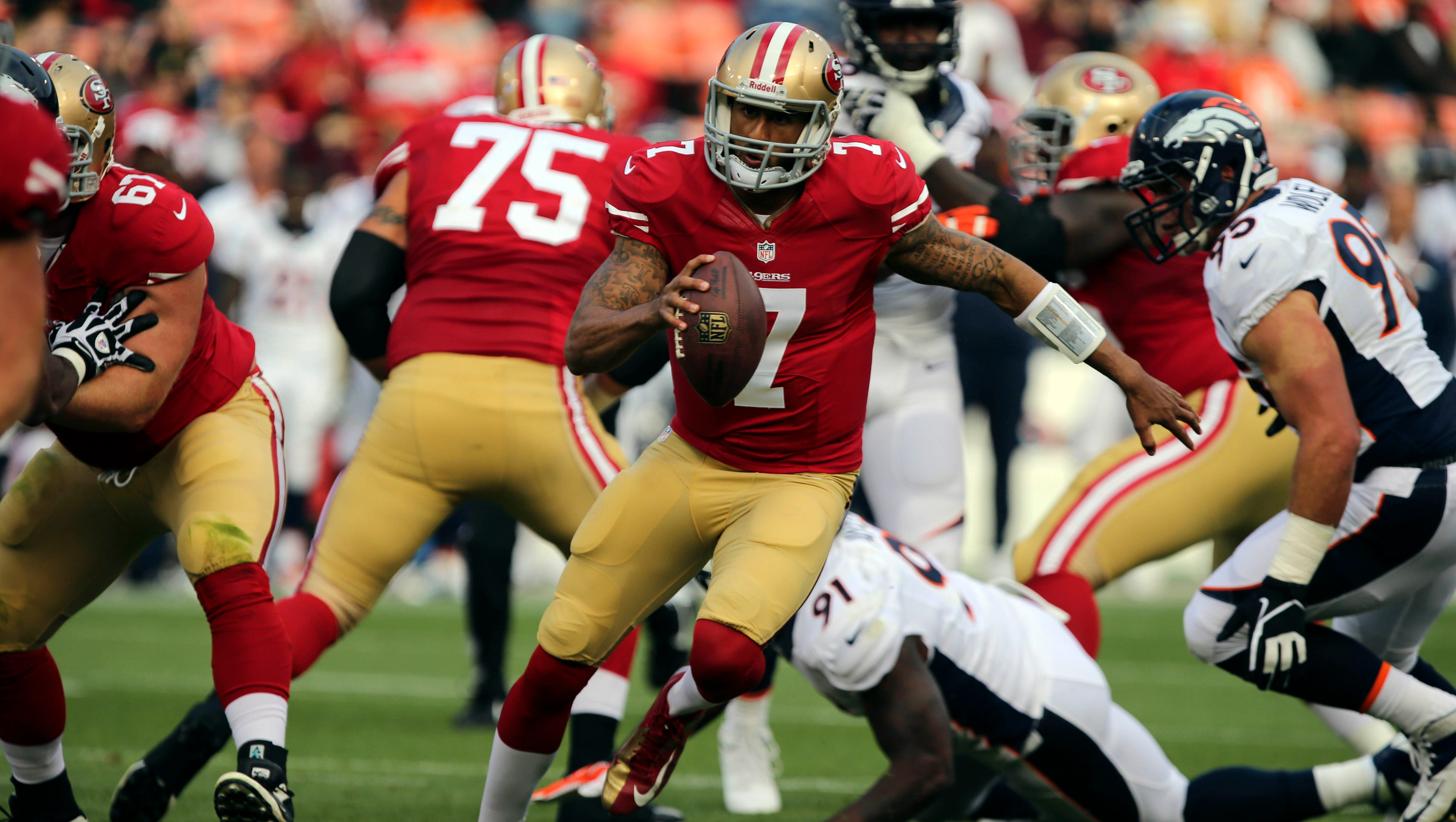 San Francisco 49ers quarterback Colin Kaepernick (7) runs against the Denver Broncos at Candlestick Park.