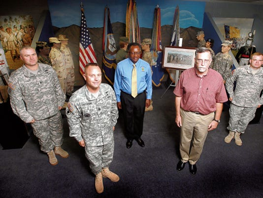 Among those who helped to renovate the Fort Bliss NCO Heritage and Education Center, formerly the Museumm of the Noncommissioned Officer, are Command Sgt. Maj. Tedd Pritchard, foreground left, curator Mark Henry, foreground right, Sgt. 1st Class Skeet Styer, left, Sylvester Smith, center, and Staff Sgt. Brandon Burkhart. They are shown in the new Heritage Center.