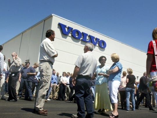 Employees and visitors gather in front of the new  30 million factory expansion at Volvo Construction Equipment in Shippensburg, Wednesday, June 30, 2010. (Public Opinion, Markell DeLoatch)