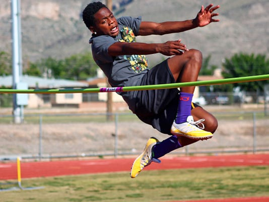 Dee Smith leaps over the bar during high jump practice Wednesday afternoon at Tiger Stadium.