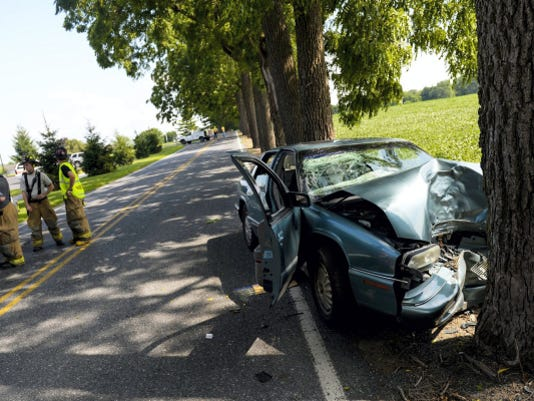 Two-people were transported to a local hospital after the car they were driving in crashed into a tree on 22nd Street in North Cornwall Township on Monday, July 20, 2015. Jeremy Long -- Lebanon Daily News