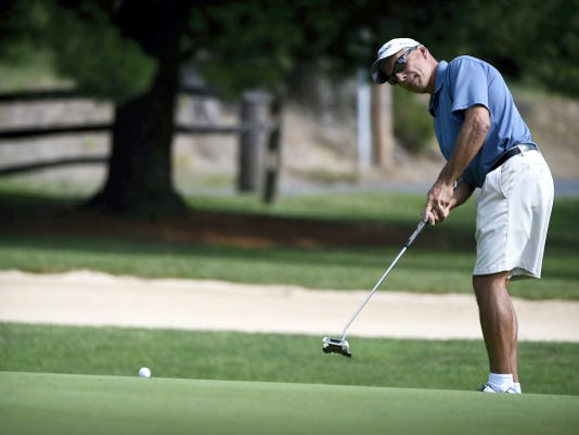 Bill Massar, Jr. putts towards the first hole during the first round of the 2015 Lebanon County Men's Better Ball Golf Championship at Fairview Golf Course on Saturday. Massar and partner Dave Berkheimer are two shots back of leaders Steve Allwein and John DiGiacomo heading into today's  final round.