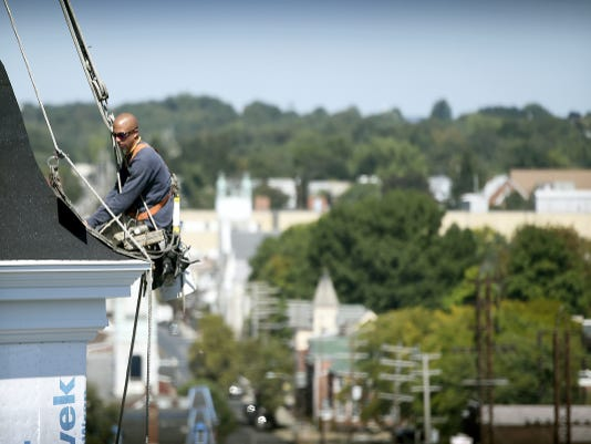 Well above the top of most of Lebanon's tallest buildings, Shane Snyder of C.J Diirner & Sons performs restoration work on the steeple of the Old Salem Lutheran Church. The 219-year-old structure was struck by lightning as recently as Aug. 20, although no damage was reported in that incident.