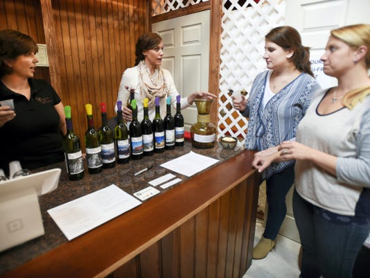 Jess Bouchette of Bouchetter Vineyards, from left, and Amanda Coleman help customers Sarah Blessing and Tiffany Armstrong sample some wines Thursday at the Lebanon Farmers Market, 35 S. Eighth St., Lebanon. Bouchette Vineyards is at 43 Nut Grove Road in Pine Grove.