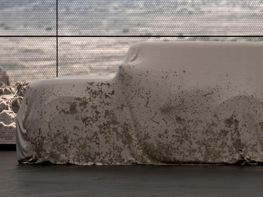 Ford teases the 2020 Ford Bronco as seen under a cover.