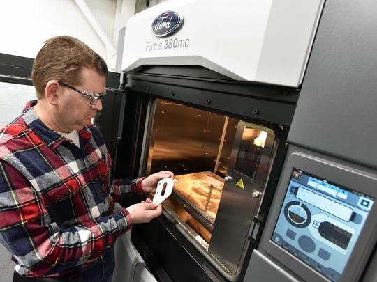 Tool maker Wayne McKinney uses the 3D printer to make small, durable temporary replacement parts in two hours Ð including idea, design and printing -- rather than wait days or weeks and disrupting factory production at the Ford Kentucky Truck Plant in Louisville, KY in February 2018.