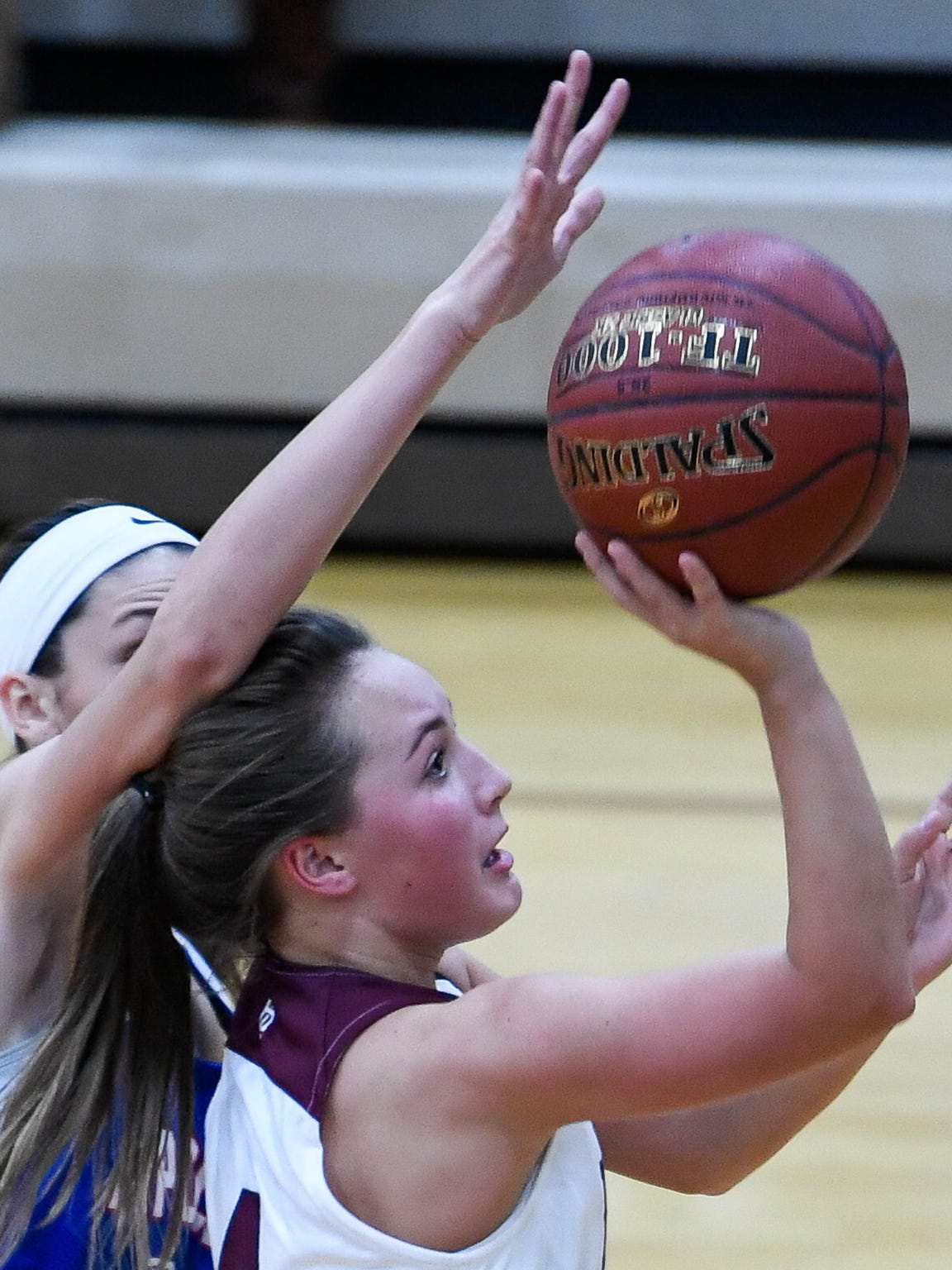 Savannah Lacer (4) takes a shot as Henderson County