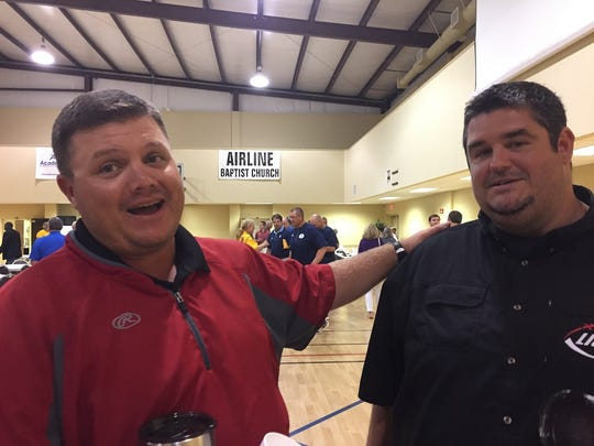 Parkway coach Neil May and Plain Dealing coach James Thurman share a moment during the 64th Bossier Lions Club Jamboree coaches dinner.