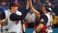 Cincinnati Reds relief pitcher Danny Graves, left, gets a high-five from catcher Jason LaRue, right, after their 10-inning, 7-6 win over the Florida Marlins Tuesday, June 1, 2004, in Miami. (AP Photo/Alan Diaz)