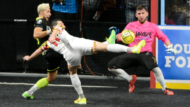 Baltimore Blast forward Tony Donatelli shoots against Milwaukee Wave goalkeeper Josh Lemos and defender Daniel Chamale in an MASL playoff game Tuesday at the UW-Milwaukee Panther Arena.