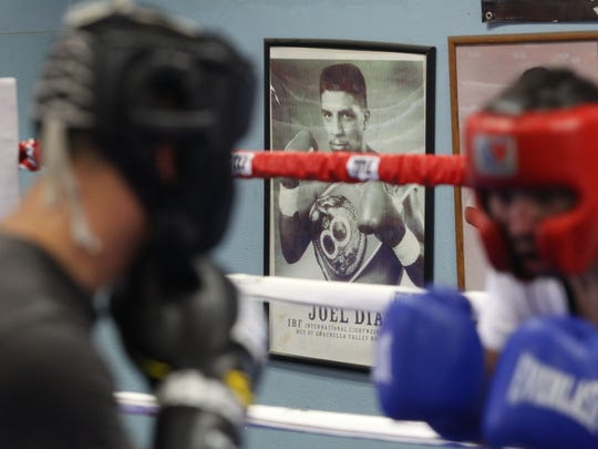 A photograph of Joel Diaz hangs at Randy Caballero's Coachella Boxing Gym as he spars in preparation for his bout against Diego De La Hoya on September 16, 2017 in Las Vegas, Nevada.