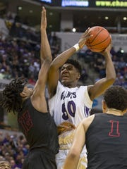 Ben Davis junior Aaron Henry (50) grimaces as he drives the ball into the defense of Fort Wayne North Side sophomore Keion Brooks (12) during the first half of the IHSAA 2017 Class 4A state championship game at Bankers Life Fieldhouse in Indianapolis, Saturday, March 25, 2017.