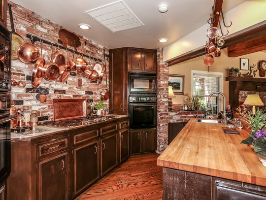 The open kitchen in the great room of the 15-acre Flanigan estate at 2750 Holcomb Ranch Lane south of Windy Hill.
