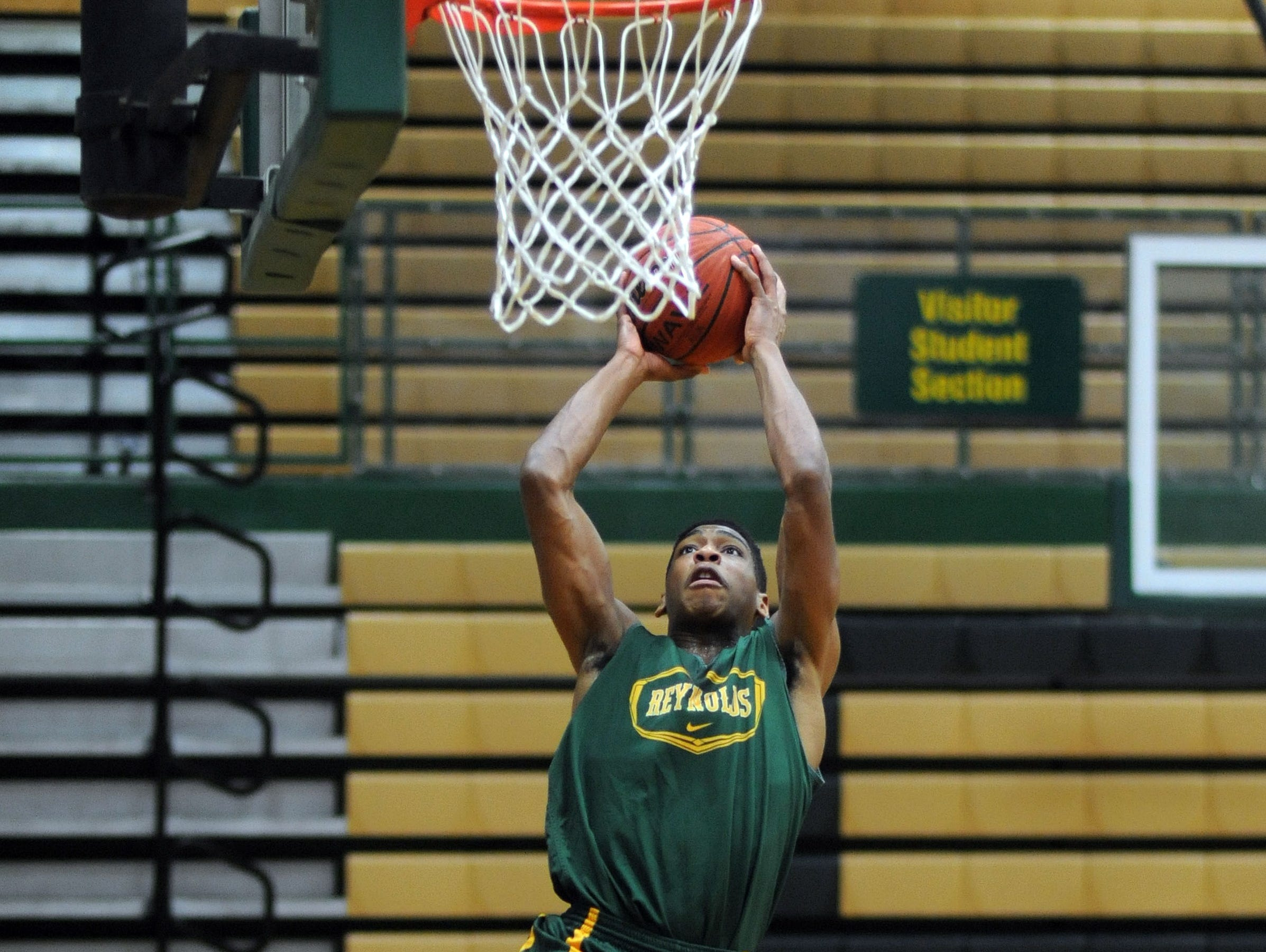 Recent Reynolds graduate JaQuann Lockhart has signed to play college basketball for Warren Wilson.